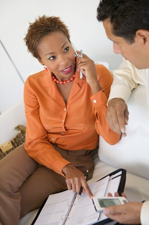Businesswoman on Cell Phone Working With Businessman Stock Photo - 5419840