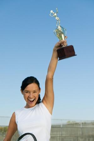 aloft: Tennis Player Holding Trophy Aloft