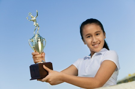 well beings: Tennis Player Holding Trophy