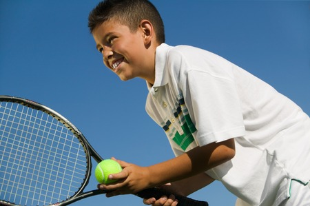 tennis racket: Young Tennis Player Preparing to Serve LANG_EVOIMAGES