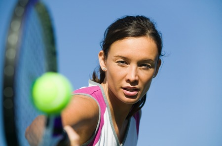 Tennis Player Hitting Ball Stock Photo - 5419883