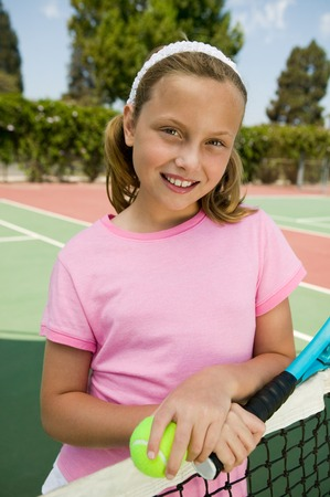 Girl at Tennis Net Stock Photo - 5419911