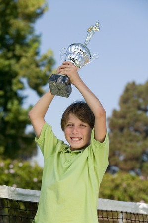 lifted hands: Boy Holding Tennis Trophy