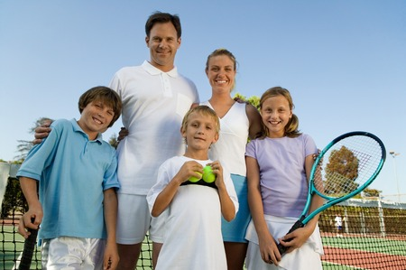 athletic gear: Family on Tennis Court