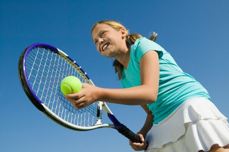 tennis racket: Girl Playing Tennis