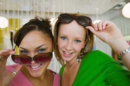 Girls Trying on Sunglasses in Boutique Stock Photo - 5419959