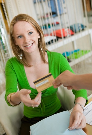Woman Paying for Clothes with Credit Card Stock Photo - 5419965