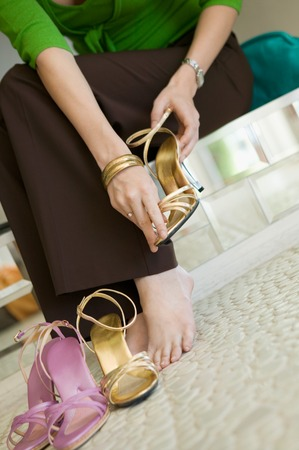decisionmaking: Woman Trying on Shoes