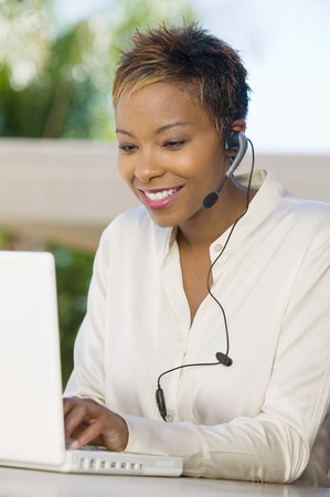 Woman Using Internet Telephone Service Stock Photo - 5419971