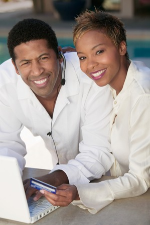 Couple Making Purchase Online with Credit Card Stock Photo - 5419973