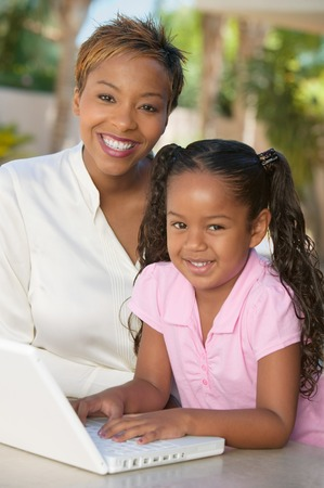 Mother and Daughter Using Laptop Stock Photo - 5419974