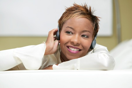 Young Woman Listening to Headphones Stock Photo - 5419977