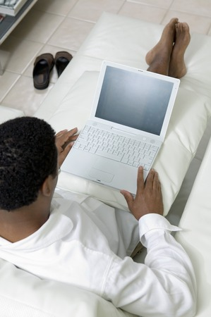 Man Relaxing and Using Laptop Stock Photo - 5419980