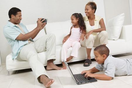 Man Videotaping Family Stock Photo - 5419983