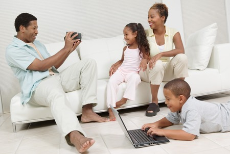 happyness: Man Videotaping Family