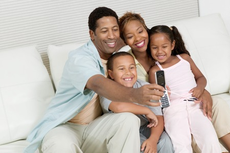 american content: Family Taking Picture with Camera Phone
