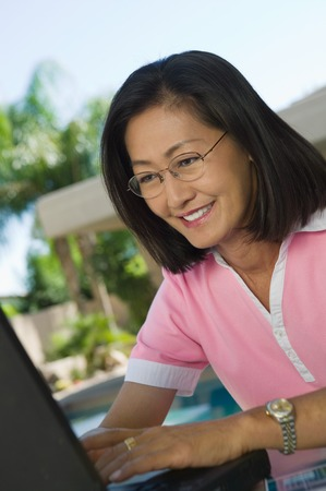 late forties: Woman Using Laptop