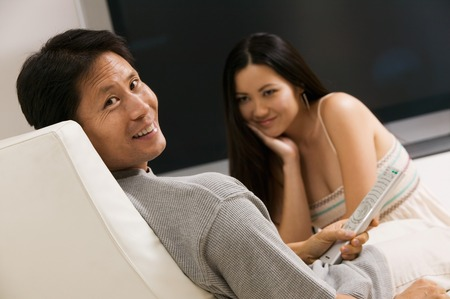 Couple in Chair with Remote Control Stock Photo - 5420002