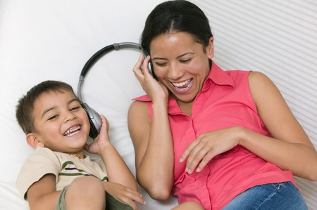 domesticity: Mother and Son Sharing Headphones LANG_EVOIMAGES