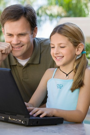 Father Watching Daughter Use Laptop Stock Photo - 5420020