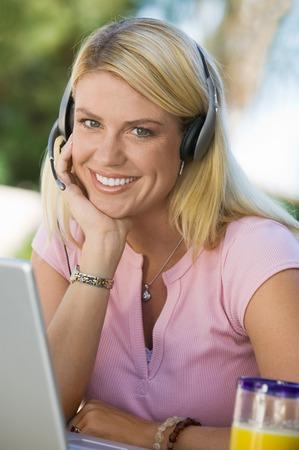 Woman Using Laptop Wearing Telephone Headset Stock Photo - 5420025