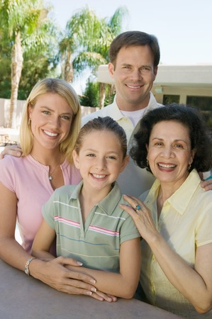 Family Posing Together on Backyard Patio Stock Photo - 5420029