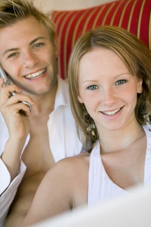 Young Couple Hanging Out Poolside Stock Photo - 5428285
