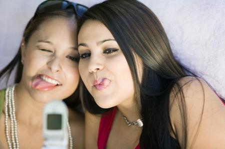 teenaged girls: Girls Posing For Camera Phone Picture