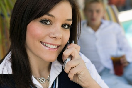 Girl Using Cell Phone Stock Photo - 5428294