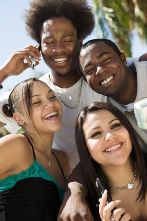 racially diverse: Friends Hanging Out Together