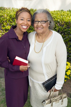only senior women: Daughter and Mother Going to Church LANG_EVOIMAGES