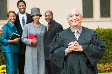 Smiling Preacher with Congregation Stock Photo - 5428326