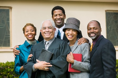 Smiling Family with Preacher Stock Photo - 5428328