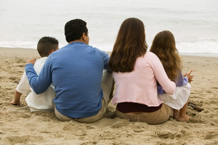 Family Sitting on the Beach Stock Photo - 5428358