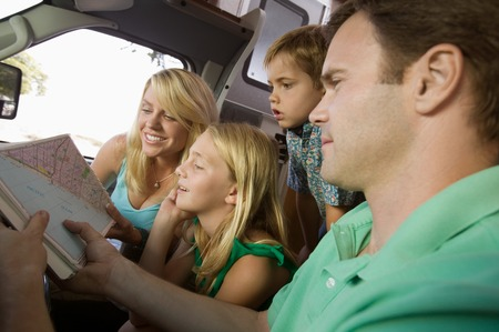 late summer: Family in RV Looking at Road Map