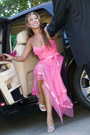 Girl Dressed for Dance Getting Out of Limo Stock Photo - 5428385