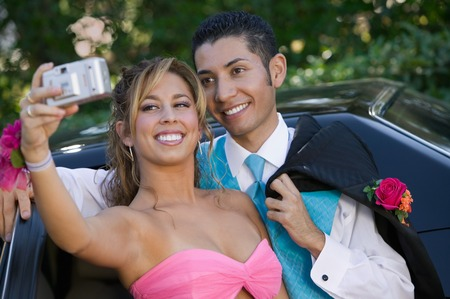 customs and celebrations: Teenage Girl Snapping Photo at Prom LANG_EVOIMAGES