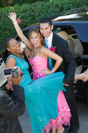 ethnic mixes: Teenagers Videotaping Their Prom LANG_EVOIMAGES