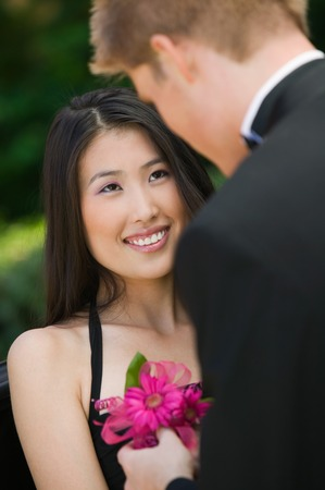 Teenage Girl Receiving Corsage from Date Stock Photo - 5428393