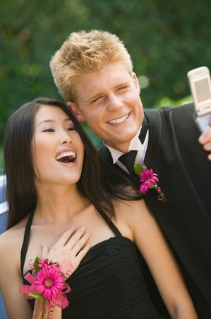 Couple Taking Their Own Photo with Cell Phone Camera Stock Photo - 5428394