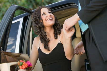 Dressed Up Girl Being Helped From Limo Stock Photo - 5428397