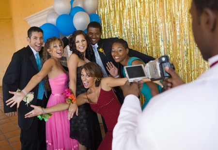 racially diverse: Group of Teenagers Hamming It Up for Prom Photo LANG_EVOIMAGES