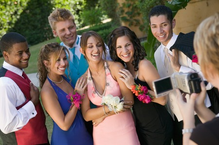 teenage girl dress: Group of Friends Being Videotaped at School Dance