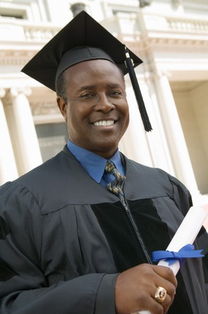 Graduate with Diploma in Front of Building Stock Photo - 5428427
