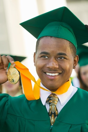 customs and celebrations: Graduate Holding Medal