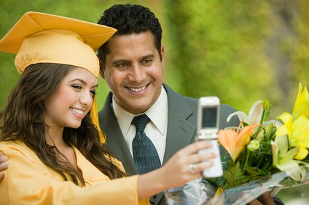 customs and celebrations: Father and Daughter Taking Picture at Graduation