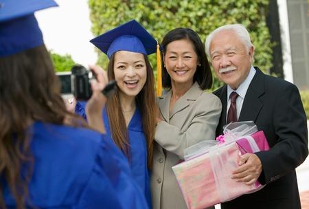Family Videotaping Graduation Stock Photo - 5428439