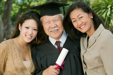Older Graduate with Family Stock Photo - 5428441