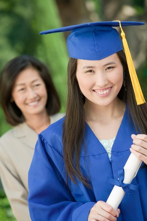 alumnae: Young Woman and Mother at Graduation LANG_EVOIMAGES