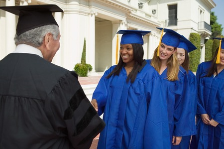 Graduate Shaking Hands and Receiving Diploma Stock Photo - 5428456